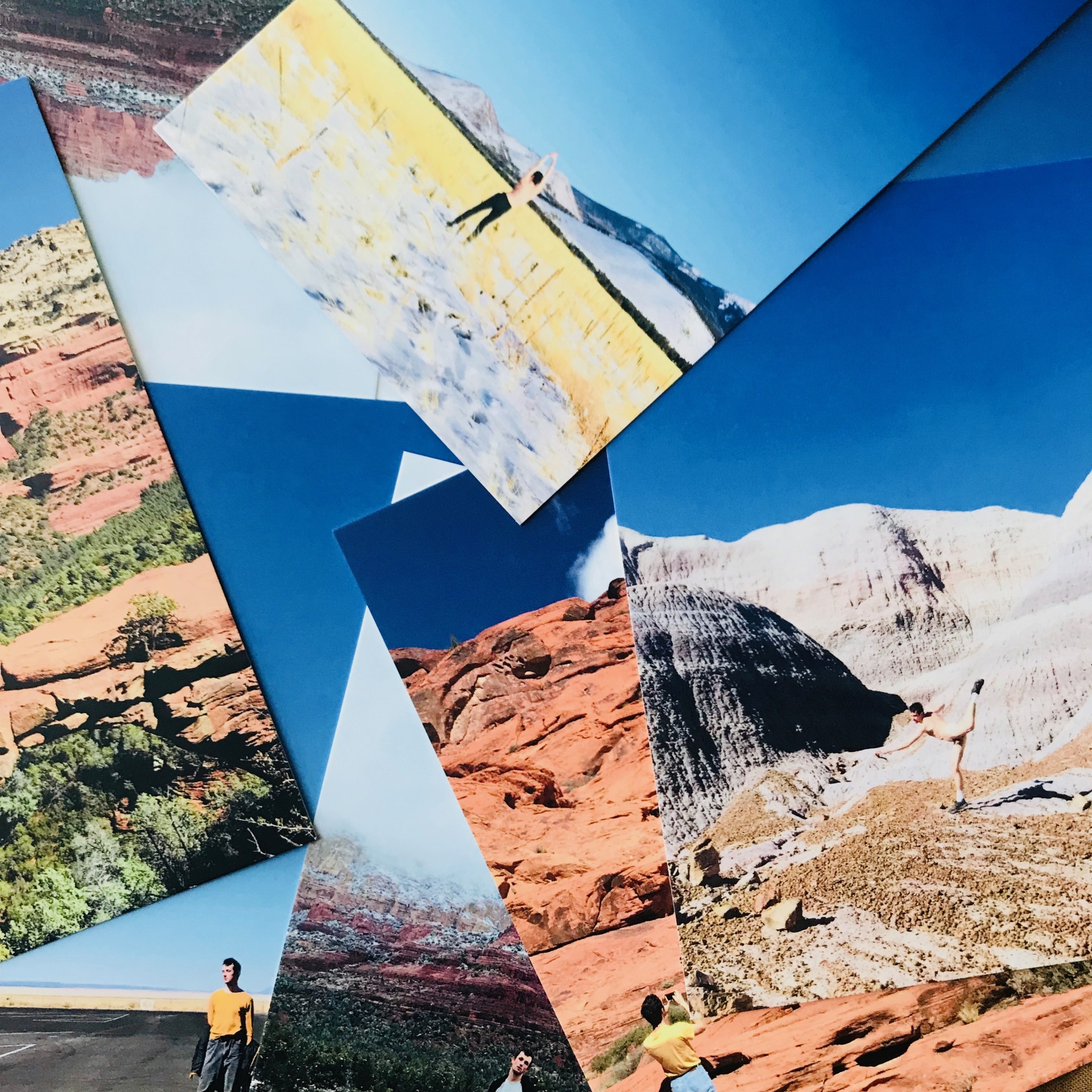 Pile of photographs of male model in American southwestern landscapes.